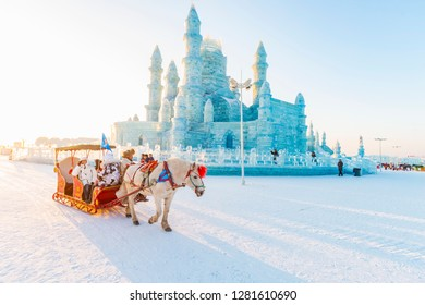 Harbin, China - January 11, 2019: Ice building. China Harbin Ice and Snow World. Tourists are visiting by the sleigh. Located in Harbin, Heilongjiang, China.