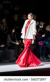 HARBIN, CHINA - JANUARY 12, 2017: Model walks runway for NE-TIGER show at Harbin Fashion Week.