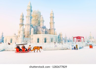 Harbin, China - January 12, 2019: Ice building. China Harbin Ice and Snow World. Tourists are visiting by the sleigh. Located in Harbin, Heilongjiang, China.