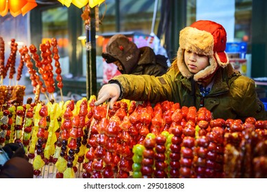 Harbin, China - January 13, 2015: Seller is selling Tomatoes on sticks in winter, traditional Chinese snacks. Located near Modern Hotel Harbin of Central Avenue(Zhongyang Street), Heilongjiang, China.