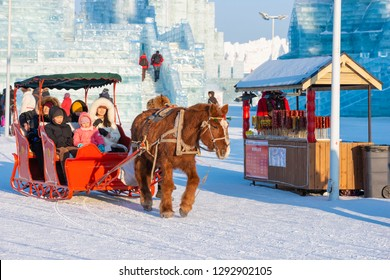 Harbin, China - January 23, 2019: Harbin International Ice and Snow Festival. Tourists are visiting by the sleigh. Located in China Harbin Ice and Snow World, Harbin, Heilongjiang, China.