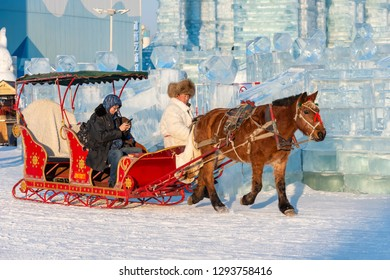 Harbin, China - January 23, 2019: Harbin International Ice and Snow Festival. Tourists are visiting by the sleigh in China Harbin Ice and Snow World. Located Harbin, Heilongjiang, China.