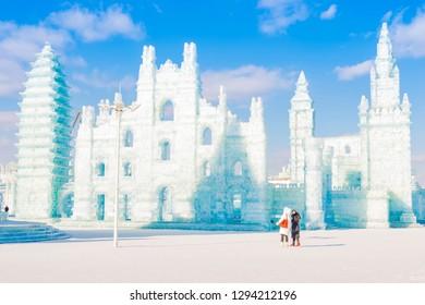 Harbin, China - January 23, 2019: Ice building. Harbin International Ice and Snow Festival. Tourists are visiting. Located in China Harbin Ice and Snow World, Harbin, Heilongjiang, China.