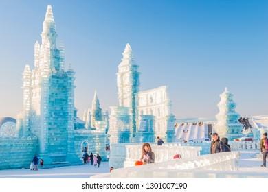 Harbin, China - January 26, 2019: Ice building. Harbin International Ice and Snow Sculpture Festival. Tourists are visiting. Located in China Harbin Ice and Snow World, Harbin, Heilongjiang, China.