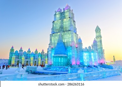 Harbin, China - January 6, 2015: Ice building in Harbin Ice and Snow World. People are visiting. Located in Harbin City, Heilongjiang Province, China.
