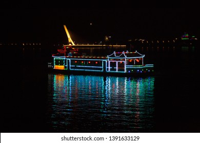 HARBIN, CHINA, OCTOBER 2, 2018: night view of tourist cruise with lights on Songhua river