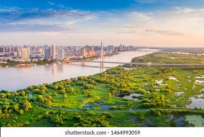 Harbin skyline. Songpu Bridge and Songhua River. Located in Harbin, Heilongjiang, China.