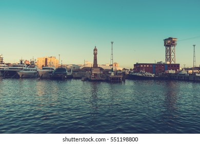 harbor of barcelona with some industrial buildings, ships and cableway
