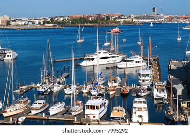 Harbor in Boston Massachusetts with boats on a sunny day