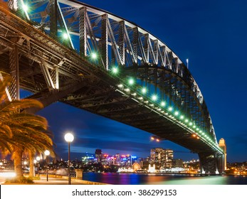 Harbor Bridge in Sydney during the night with city lights and dark sky