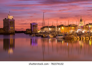 Harbor by night with beautiful sunset in La Rochelle Town, France.