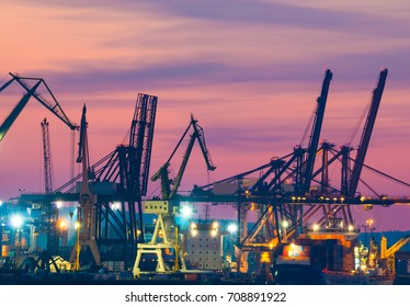 Harbor cranes in the sea port by night in city of Gdynia- Poland, Europe.