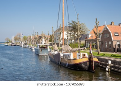 Harbor Dutch city Medemblik with old historical wooden sailing ship