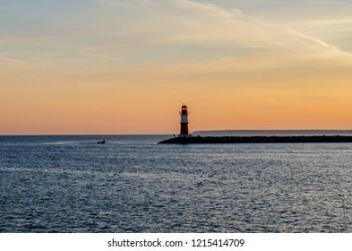 harbor entrance in Warnemünde-Rostock with 1 lighthous in morning light