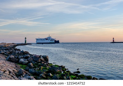 harbor entrance in Warnemünde-Rostock with 2 lighthouses and ferry