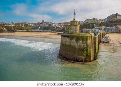 Harbor entrance in Newquay with beach