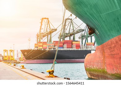 Harbor enviroment: Ship-to-shore cranes unloading containers from a ship. Transportation industry and shipment logistics. Export and import bussines. Freighter moored in port