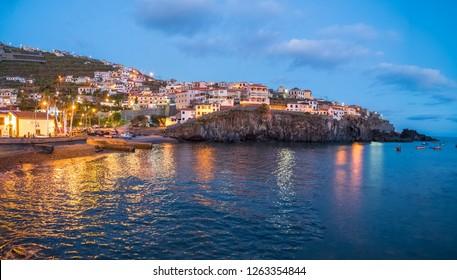 Harbor and fishing village Camara de Lobos at twilight time, Madeira island, Portugal