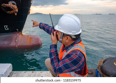 harbor master supervisor is survey and inspection of the safty berthing along side of the ship vessel mooring in port terminal, report and communication by radio walkie talkie