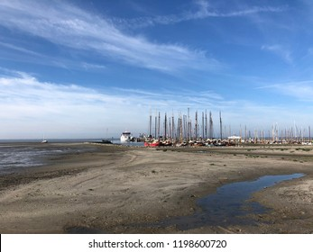 Harbor on Ameland island during low tide in Friesland The Netherlands