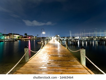 Harbor Peer(Dock) at dusk, with ships in distance and stars in sky