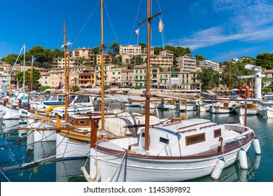The harbor of Port de Soller (Spanish: Puerto de Soller), Majorca, Spain, with white fishing boats on a sunny summer day.