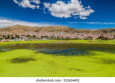 Harbor in Puno with the city in the background, Peru