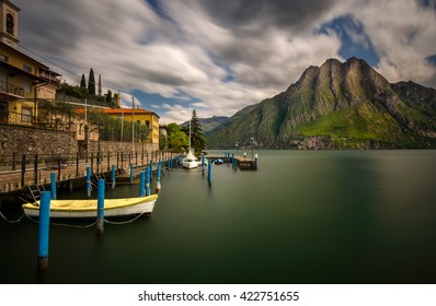 Harbor of Riva di Solto on Iseo Lake with mountains on background, Italy