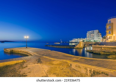 Harbor at St Paul Bay on the Island of Malta at night