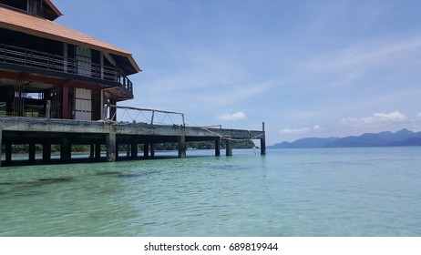 Harbor for tourist boat, clean clear beach, blue sky and hottest day in summer vacation at koh wai, Thailand. Copy space for text.