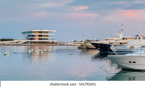The harbor of  Valencia in Spain with  during sunset with America's Cup Building (Veles e Vents) in the background