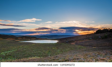 Harbottle Lake at Sunset, which is located in the hills above the village of Harbottle that lies in Coquetdale inside the Northumberland National Park, within the Cheviot Hills