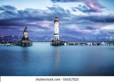 The harbour in bavarian city Lindau (Bodensee) and alps in background is one of the best-like travel spots, when you underway at the Bodensee region.