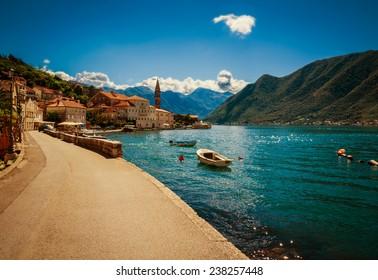 Harbour and boats at Boka Kotor bay (Boka Kotorska), Montenegro, Europe. Image with retro toning.