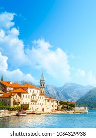 Harbour and boats in sunny day at Boka Kotor bay (Boka Kotorska), Montenegro, Europe