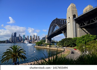 The Harbour bridge with city view of Sydney.Beautiful landmark in Australia. Natural park nearby the bridge.Relaxing place with beautiful sky.Nature and architecture background with copy space.