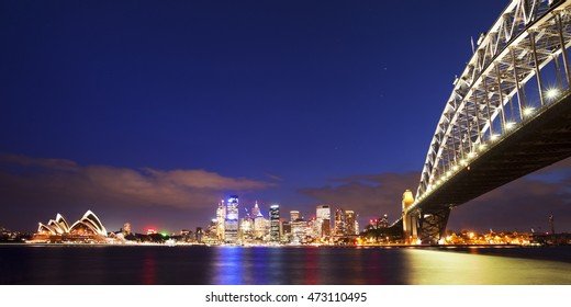 The Harbour Bridge, Sydney Opera House and Central Business District of Sydney. Photographed at night.