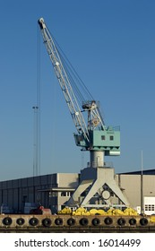Harbour crane and warehouse at an industrial port