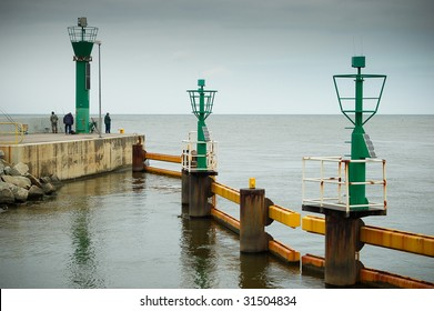 Harbour entrance with hurricane lamps.