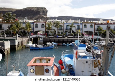 the harbour of the fishing village of  Puerto de Mogan in the south of Gran Canay on the Canary Island of Spain in the Atlantic ocean.  Gran Canary, Puerto de Mogan, February, 2006