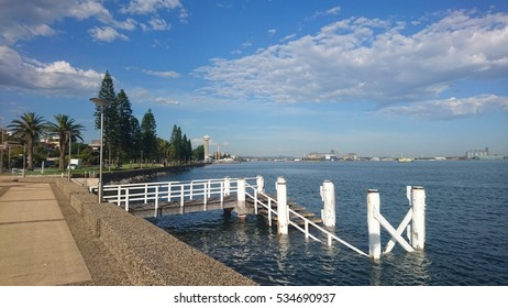 Harbour foreshore with wharf in foreground, Newcastle,  Australia