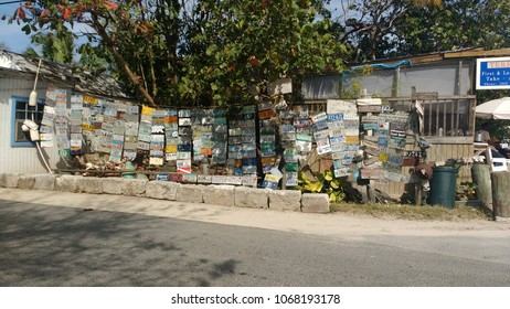 HARBOUR ISLAND, ELEUTHERA, BAHAMAS - MARCH 12, 2017. Car plates hanging and decorating the streets down town Harbour Island