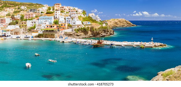Harbour with marine vessels, boats and lighthouse. Panoramic view from a cliff on a Bay with beach Bali - vacation resort, with secluded beaches and clear ocean waters, Rethymno, Crete, Greece