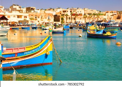 Harbour of Marsaxlokk village in Malta with colourful fishing boats