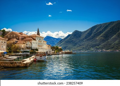 Harbour in Perast at Boka Kotor bay (Boka Kotorska), Montenegro, Europe. Retro style toning image.
