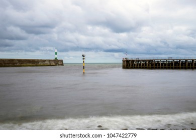 Harbour with stone jetty and pier in Aberystwyth Ceredigion Wale
