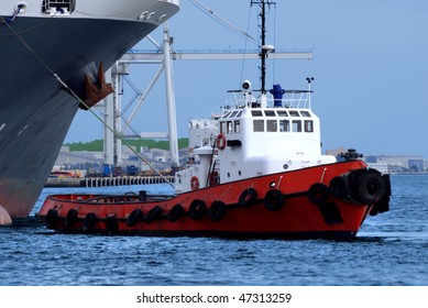 Harbour tugboat at work.