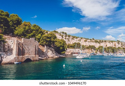 Harbour with yachts and boats in rocky inlet of Calanques in Cassis near Marseille, France