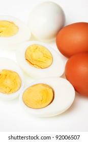 Hard boiled chicken eggs over white background