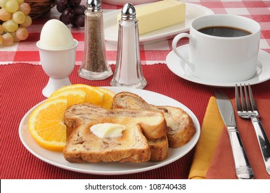 a hard boiled egg with cinnamon toast and coffee